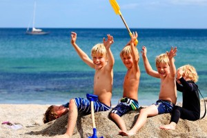 Children enjoying on the beach