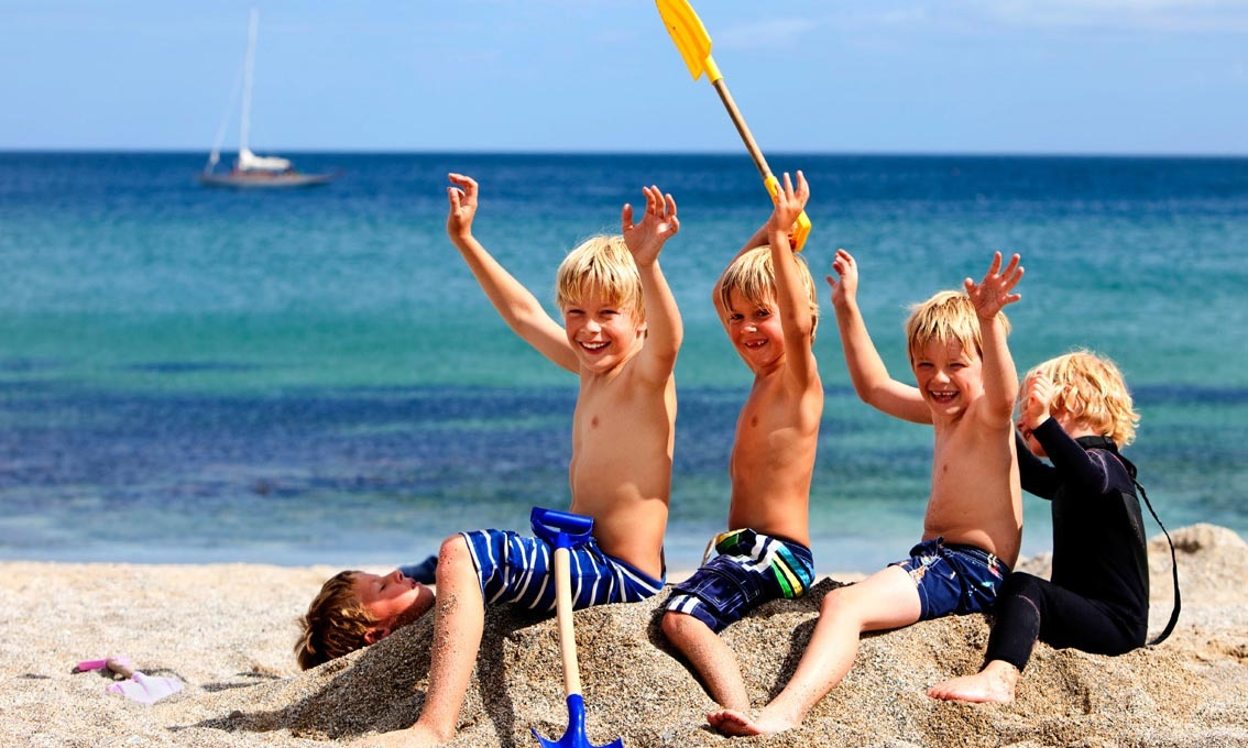 Children enjoying on the beach